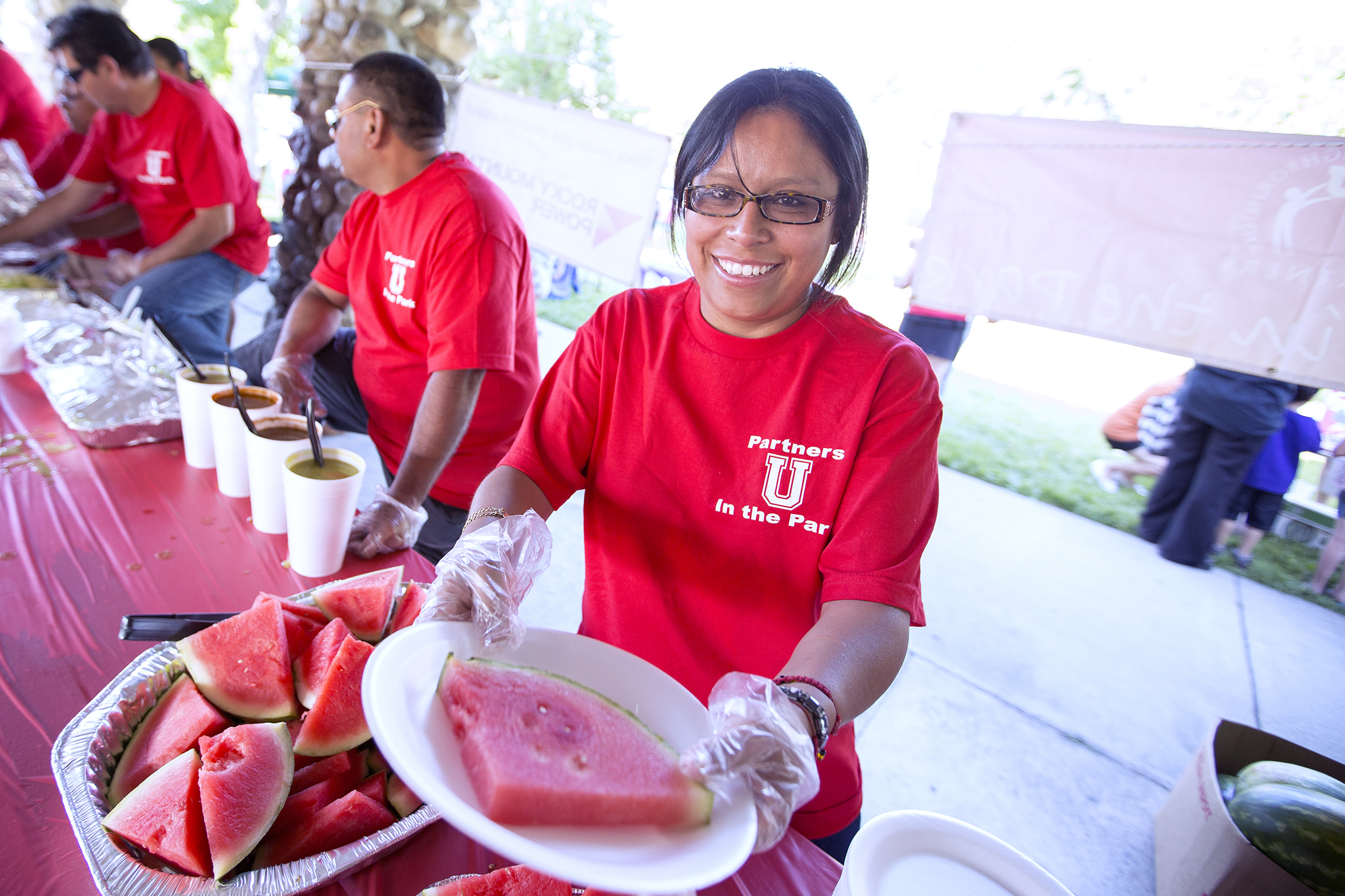University Neighborhood Partners at the University of Utah celebrates the college graduation of nearly 300 west Salt Lake residents at its first Partners in the Park event of the season.