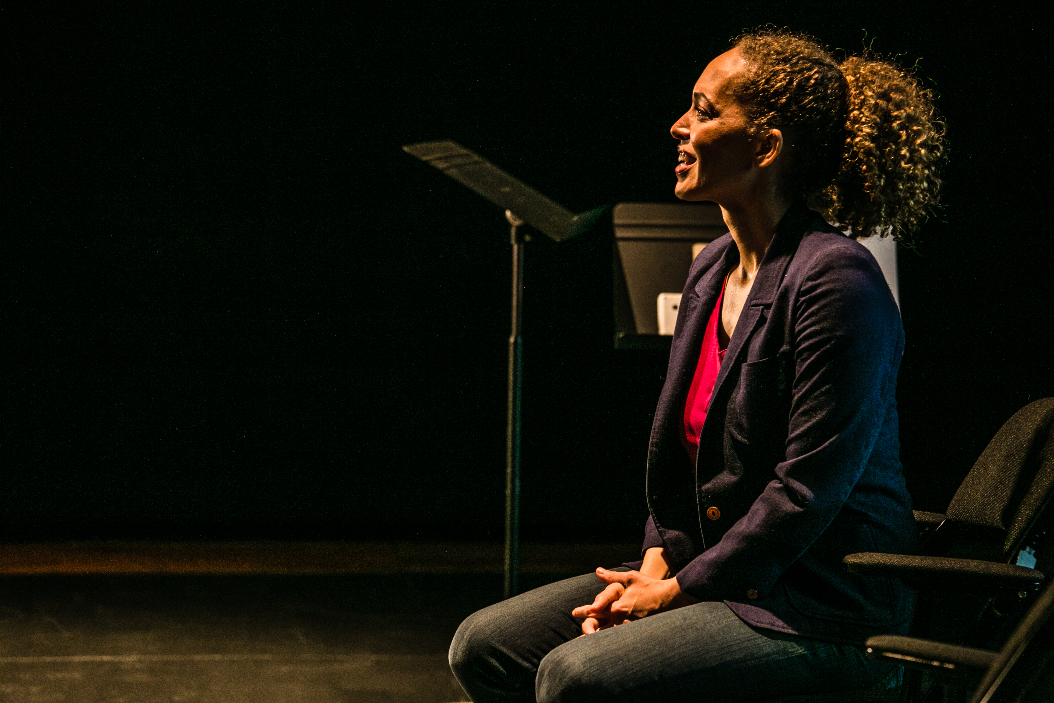 """Fanshen Cox DiGiovanni performing her one-woman show, """"One Drop of Love,"""" about the evolution of race in the United States and how it affects relationships."""