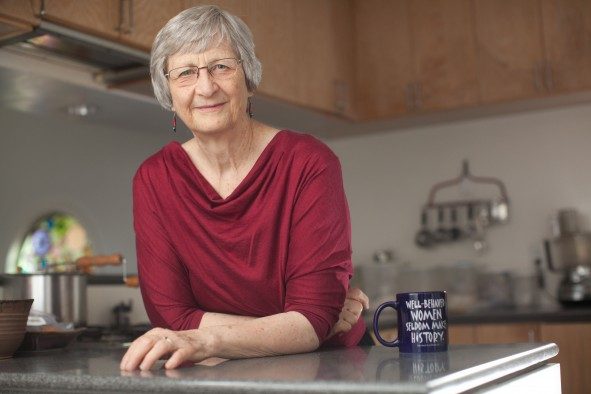"""Portrait of Harvard history professor Laurel Ulrich with a mug printed with her most famous line, """"Well-behaved women seldom make history"""" at her home in Cambridge, Mass. June 25, 2012.  Photo by Erik Jacobs"""
