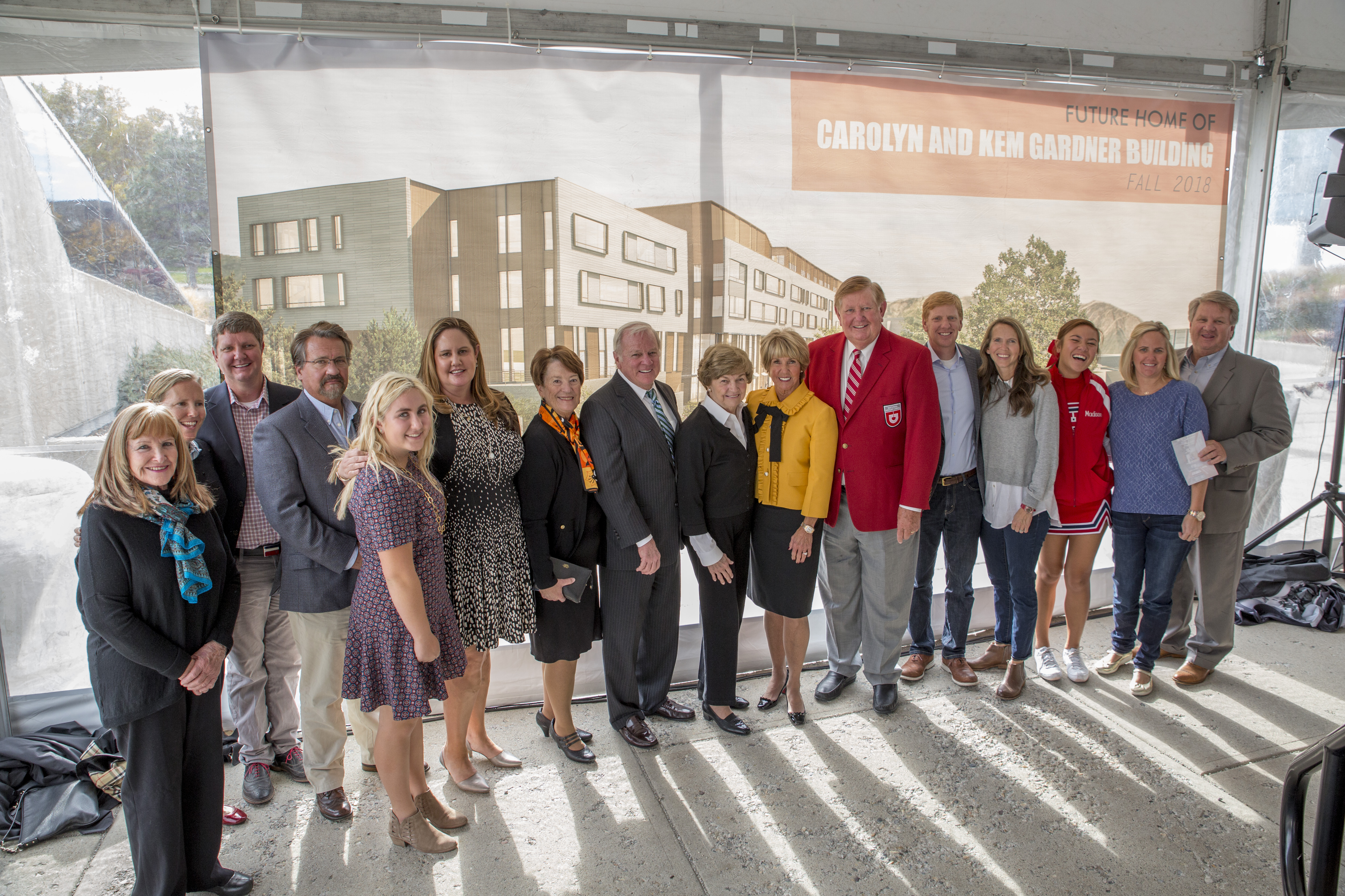 Carolyn and Kem Gardner are joined by their extended family at the unveiling ceremony for the new building.