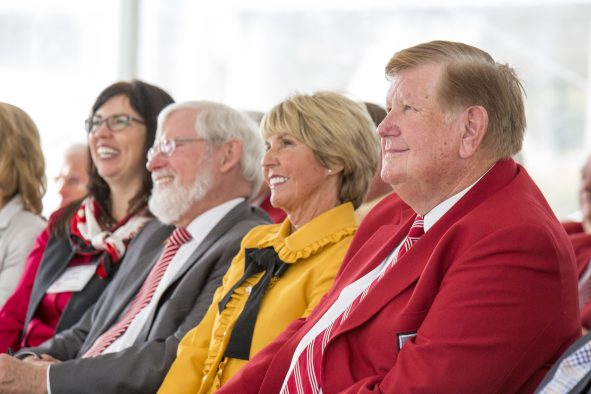 Kem and Carolyn Gardner with U President David W. Pershing at the unveiling ceremony for the new building named after the Gardners.