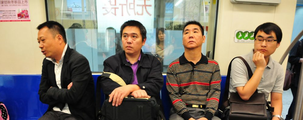 Men in a subway train in China, Oct 6 2012. Photo by Flickr user Jun Wei Dai